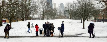 A team of young adults filming in the snow